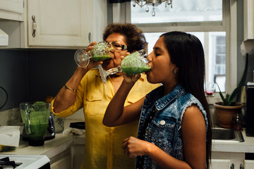 Grandmother and granddaughter drinking smoothies
