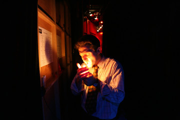 Patrick Mazet lights up a cigarette backstage during preview performance of Cabaret at the Folies Bergere in Paris