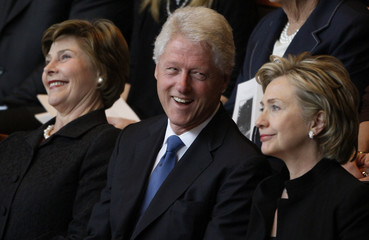 U.S. first lady Laura Bush, former President Bill Clinton, and former first lady and presidential hopeful Hillary Clinton react to a remembrance speech during a funeral service for former first lady Lady Bird Johnson in Austin,