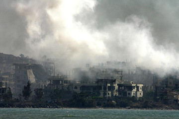Smoke from artillery and tank shelling rise from the Palestinian Nahr al-Bared refugee camp in northern Lebanon