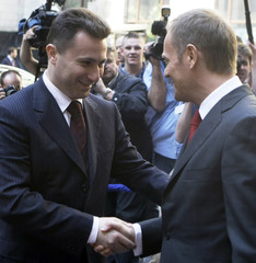 Poland's Prime Minister Donald Tusk shakes hands with his Macedonian counterpart Nikola Gruevski at the beginning of the European People's Party Congress in Warsaw