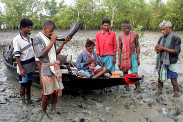 Traditional honey collectors pray before they start collecting honey at Bali Island in the Sunderbans ...