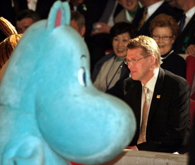 """Finland's PM Vanhanen is welcomed by Finnish cartoon """"Moomin"""" character at World Expo in Nagoya."""