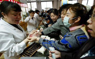 BEIJING RESIDENTS CROWD A CHINESE PHARMACY TO BUY TRADITIONAL HERBALMEDICINE IN BEIJING.