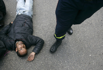 A demonstrator faints during a protest in Rabat