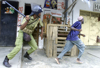 POLICE BEAT UP A SUSPECTED STONE THROWER.