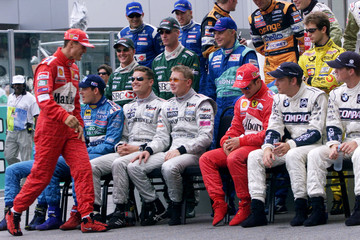 World Champion Michael Schumacher arrives last to the end of the season team photo before the Malays..