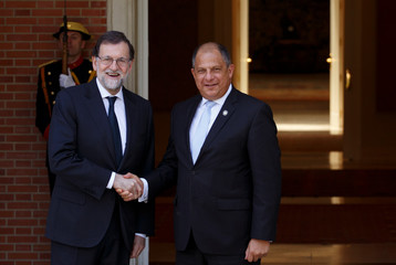 Spain's PM Rajoy shakes hands with Costa Rica's President Solis at Moncloa Palace in Madrid