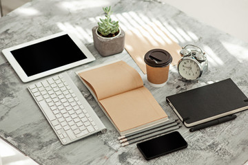Office desk table with computer, supplies and phone