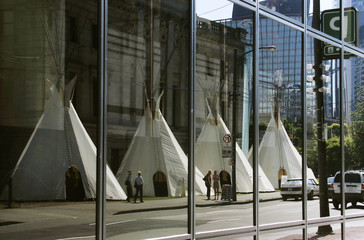 NORTH AMERICAN NATIVE TEEPEES REFLECTED IN MODERN BUILDINGS IN VANCOUVER.