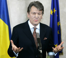 Ukrainian President Yushchenko listens to a question at a news conference in Brussels.