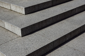Abstract stairs , abstract steps, stairs in the city, granite stairs,wIde stone stairway often seen on monuments and landmarks,wide stone stairs, steps,black and white photo,diagonal