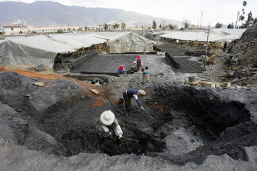 Labourers work at brick factory in Heqing village of Dali city, southwest China's Yunnan province
