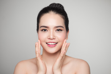 Asian woman touching her face.