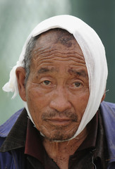 An injured survivor is seen at a temporary clinic in earthquake-hit Mianzhu