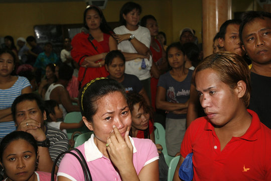 Anxious relatives of passengers feared trapped inside capsized passenger ferry Princess of the Stars wait for latest news on their loved ones inside Sulpicio Lines terminal in the port area of Manila