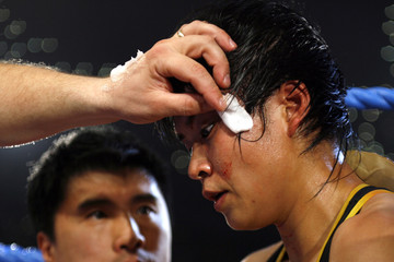Zhang Xiyang of China receives medical aid during the W.B.C. world championship flyweight title in Monte Carlo