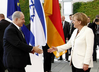Israel's Prime Minister Netanyahu is welcomed by German Chancellor Merkel at the chancellery before bilateral talks in Berlin