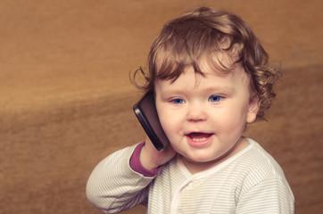 Little girl talking on the phone