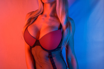 Big breasts in corset bra from above / Woman with big breasts / sexy girl isolated background / night club or bar hot blonde with long hair / evening romantic party