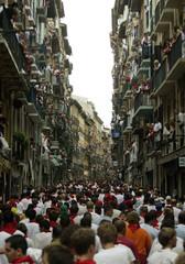 RUNNERS CROWD ESTAFETA STREET SECONDS BEFORE THE THIRD BULL RUN OF THESAN FERMIN FESTIVAL IN PAMPLONA.