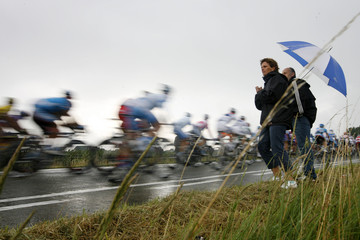The pack of riders cycle during the second stage of the 94th Tour de France