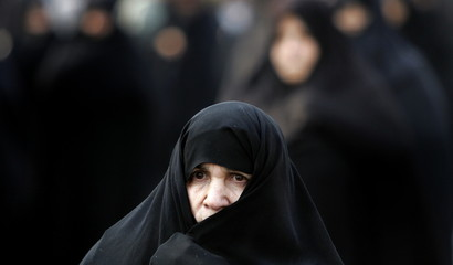 Iranian worshippers leave Tehran university after Friday prayers in Tehran December 30, 2005. [Russi..