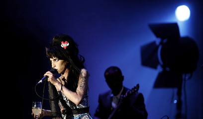 """British singer Winehouse performs during """"Rock in Rio"""" music festival in Lisbon"""