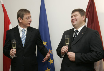 Hungary's PM Gyurcsany speaks to his Latvian counterpart Kalvitis during opening ceremony of Hungary's embassy in Riga