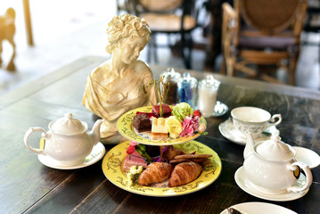 Afternoon English high tea set, Croissant and cake.