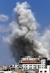 Smoke rises from buildings inside Palestinian President Yasser Arafat's compound in the West Bank Ci..