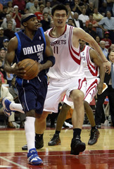 Mavericks Terry drives baseline against Rockets Yao during second half of Game Four in Houston.