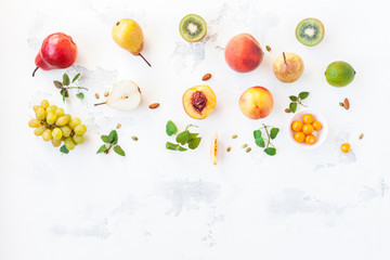 Fresh fruits on white background. Flat lay, top view, copy space