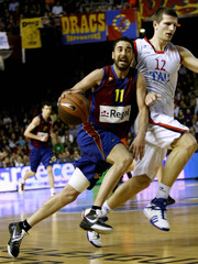 Barcelona's Navarro goes to the basket as Tau Ceramica's Teletovic try to block during Euroleague quarter-final basketball game in Barcelona