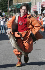 Lewis competes in codfish relay race at annual Fishermens Festival in Boothbay Harbor Maine