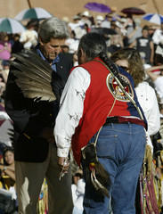 John Kerry blessed by tribal dancer at inter-tribal ceremonial powwow.