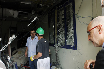 Basque Socialist Rodolfo Ares visits the damage caused by a bomb at the regional headquarters of the Basque Socialist Party in the Spanish northern town of Durango