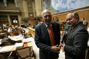 Swiss Interior Minister Couchepin talks to Swiss Defence and Sport Minister Schmid during the national council's autumn session in Bern