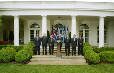 US President Bush makes a statement on Free Trade Agreement in Rose Garden alongside Central American ...