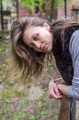 A young beautiful girl with long hair walks through the spring Stryjsky park in Lviv