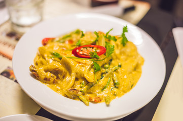 Thai yellow curry with shrimps. Thai food concept
