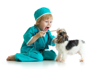 Say aaah - child weared doctor clothes playing veterinarian