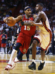 New Jersey Nets Vince Carter gets tangled up with Miami Heat's Dorell Wright during the second quarter of NBA basketball action in Miami