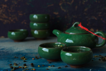 Traditional green Chinese teapot and cups