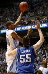 The University of North Carolina's Brandan Wright goes to the basket against Duke University's Brian Zoubek in Chapel Hill