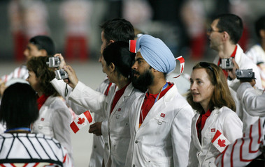 Members of the Canadian delegation parade during the opening ceremonies of the Pan American Games in Maracana Stadium in Rio de Janeiro