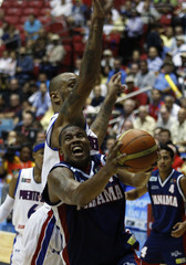 Lloreda of Panama goes for the basket against Ramos of Puerto Rico in the men's FIBA Americas Championship quarterfinal basketball game in San Juan