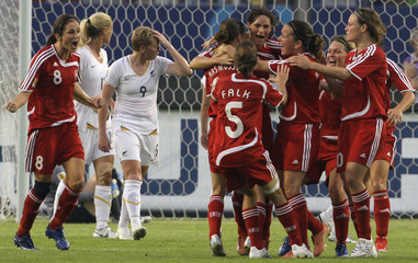 New Zealand's Henderson reacts after Denmark's Pederson kicked a goal during their group soccer match in the 2007 FIFA Women's World Cup at the Wuhan Sports Centre Stadium