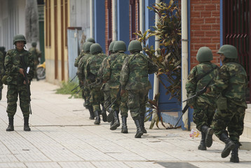 Soldiers patrol streets next provincial government building at Cobija town