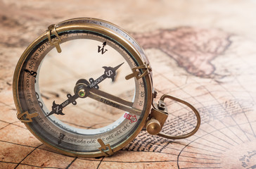 Wall Mural - Old compass on vintage map. Retro style.